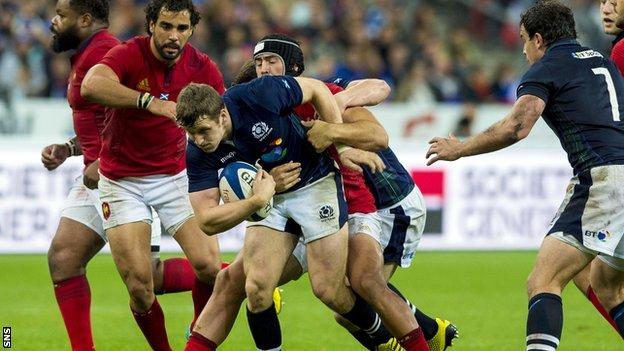Mark Bennett is tackled by Alexandre Dumoulin in the 19-16 defeat to France