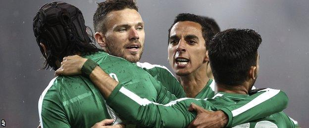 Marcus Berg, second from left, after putting Panathinaikos ahead