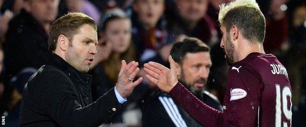 Hearts boss Robbie Neilson congratulates striker Juanma