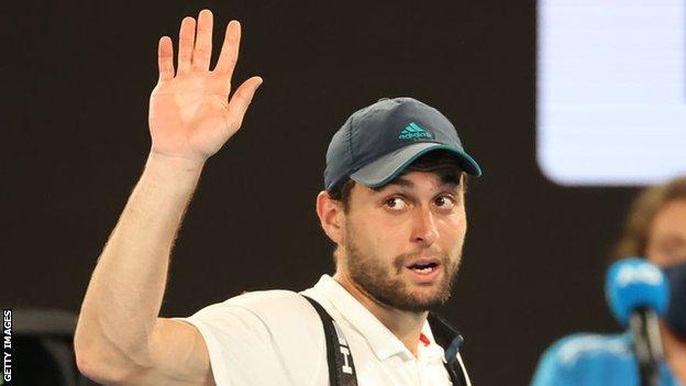 Aslan Karatsev waves goodbye to the Melbourne crowd after losing to Novak Djokovic