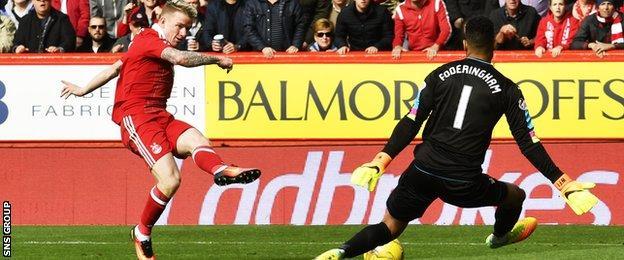 Jonny Hayes shoots low past Wes Foderingham