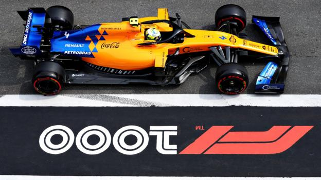 Lando Norris of McLaren drives past 1,000 track graphic