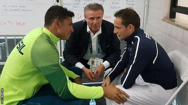 """""""Pole-vaulter Renaud Lavillenie consoled by Thiago Braz and Sergei Bubka after he was booed at medal ceremony"""", tweeted the IOC Media account"""