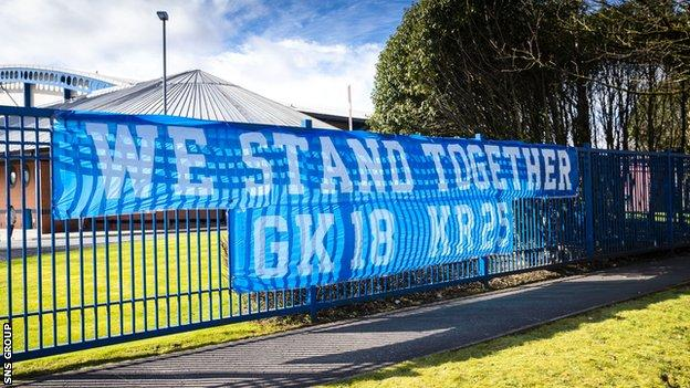 Rangers fans leave a banner at the club's training ground in support of Glen Kamara and Kemar Roofe