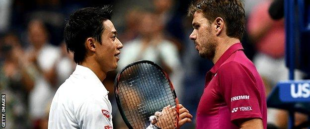 Stan Wawrinka (R) of Switzerland is congratulated by Kei Nishikori