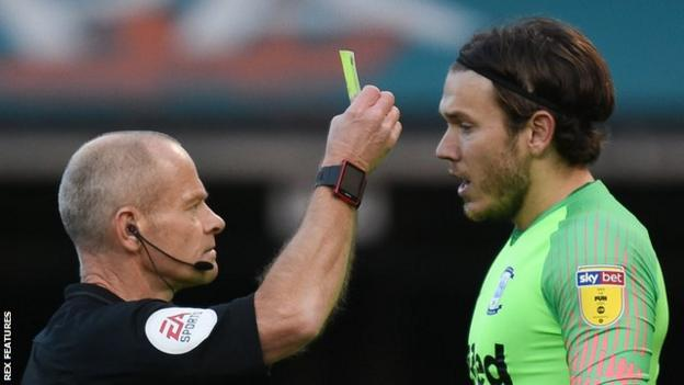Chris Maxwell receives his second yellow card of the afternoon and is sent off by referee Andy Woolmer