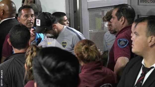 Boca Juniors midfielder Pablo Perez (centre) and defender Leonardo Balerdi return from hospital to the Monumental stadium