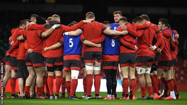 Wales players in a squad huddle during the 2020 Six Nations