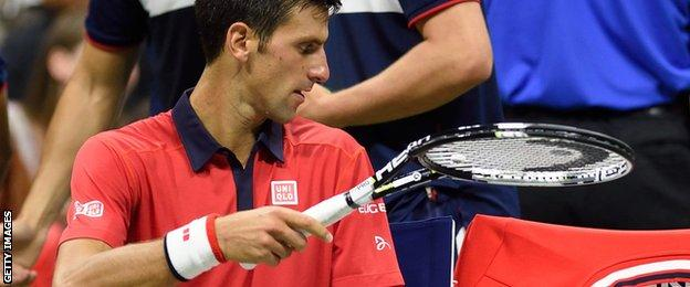 Novak Djokovic and a broken racquet