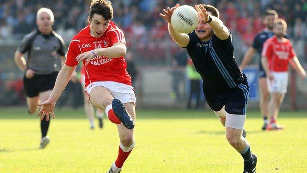 Trillick's Lee Brennan has his shot blocked by Danny Gorman in the Tyrone final
