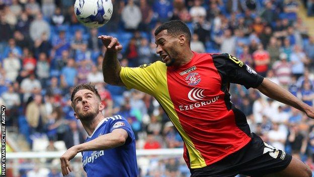 Cardiff City's Craig Noone in action against David Davis of Birmingham City