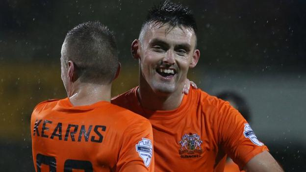 A delighted Eoin Bradley celebrates scoring a late winner to give Glenavon a 2-1 victory over the Swifts