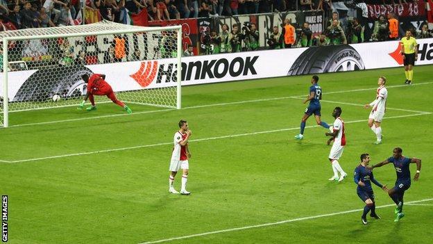Paul Pogba (bottom right) celebrates scoring the opening goal