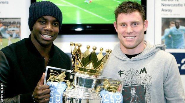 Micah Richards and James Milner with the Premier League trophy