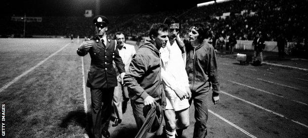 Hunter is led from the pitch after being sent off in a controversial European Cup Winners' Cup final defeat by AC Milan