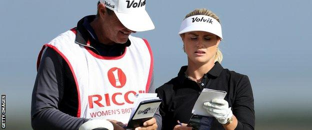 Carly Booth consults her caddie during the Women's British Open at Kingsbarns