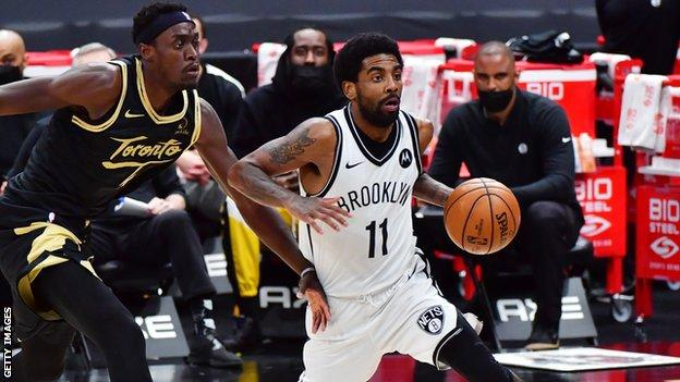Brooklyn's Kyrie Irving in action against Toronto