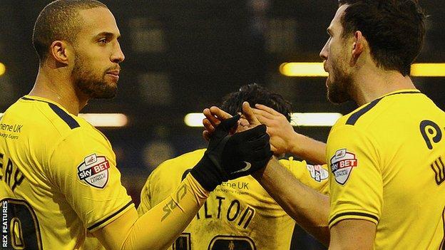 Jordan Bowery celebrates his debut goal for Oxford United