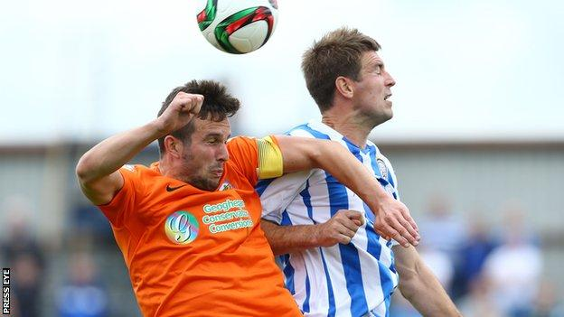 Linfield striker Andrew Waterworth and Coleraine's Steven Douglas contest a high ball
