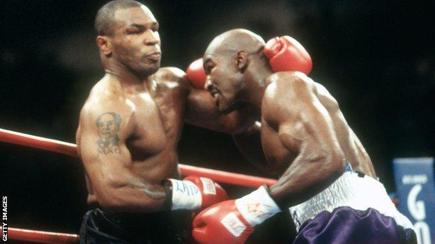 Mike Tyson (left) against Evander Holyfield