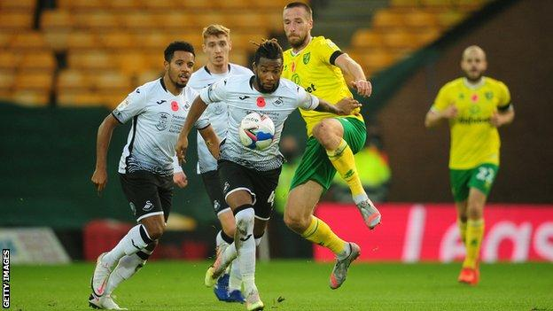 Kasey Palmer of Swansea City under pressure from Marco Stiepermann of Norwich City