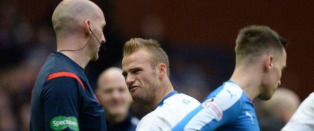 Referee Bobby Madden and Kilmarnock midfielder Kallum Higginbotham