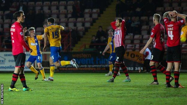 Mansfield's Ryan Tafazolli celebrates his 82nd minute winner