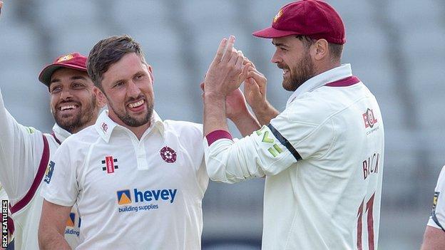 Simon Kerrigan celebrates a wicket for Northamptonshire against Lancashire