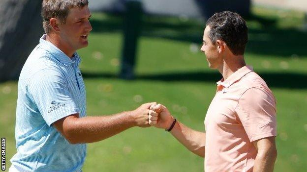 Bryson DeChambeau and Rory McIlroy fist-bump at Colonial Country Club