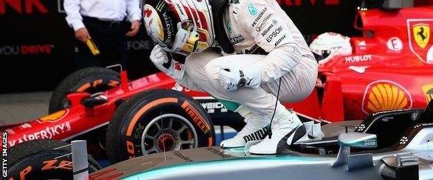 Hamilton celebrates on car