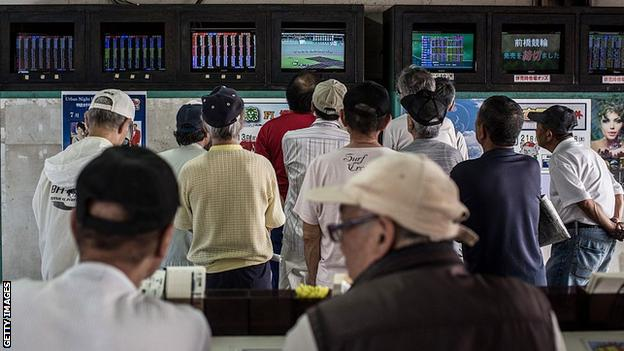 Punters gambling on keirin racing in Japan watch broadcasts of races around the country