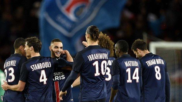 Paris St-Germain's players celebrate scoring against Troyes