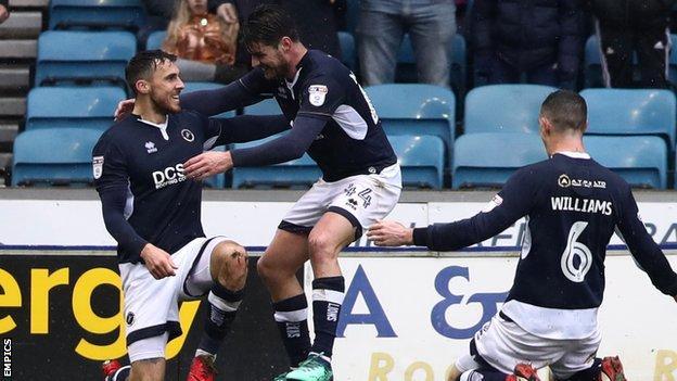 Lee Gregory celebrates on one knee after scoring against Nottingham Forest