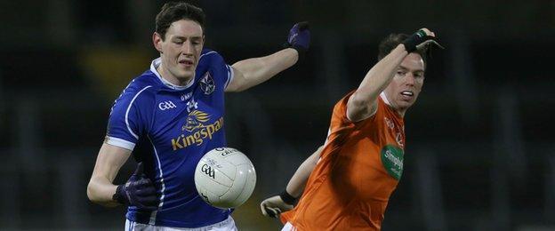 Cavan forward Michael Argue attempts to move clear of Armagh's Tony Kernan