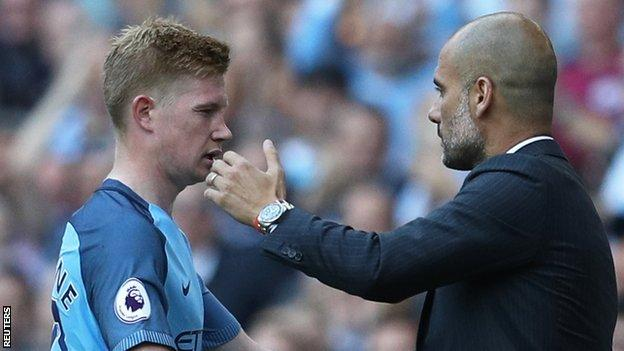 Man City midfielder Kevin de Bruyne and manager Pep Guardiola