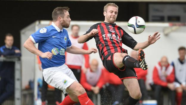 Midfielders Jamie Mulgrew and Richard Clarke keep their eyes on the ball as Linfield go down 3-0 to Crusaders at Seaview