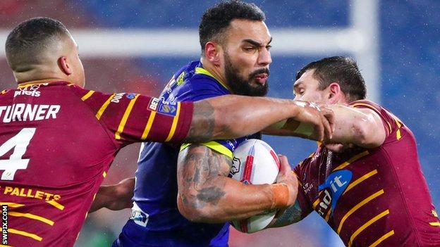 Warrington's Ryan Atkins is tackled