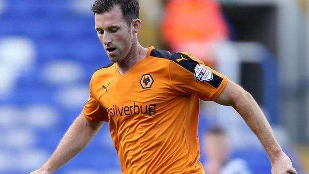 Newcastle defender Mike Williamson in action for Wolves