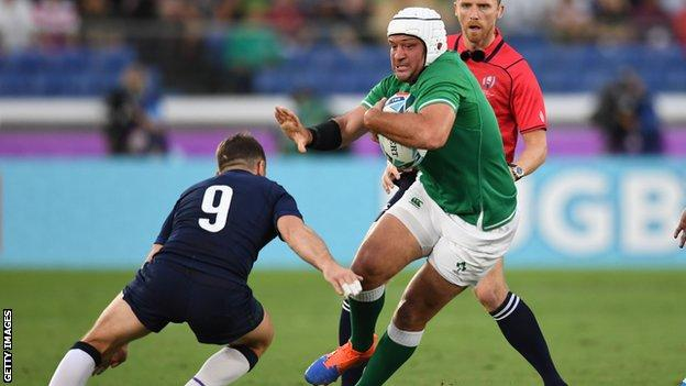 Rory Best attempts to get past Scotland's Greig Laidlaw in Yokohama