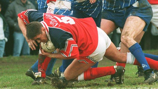 Paul Jones scoring a try for Llanelli against Bridgend in 1996