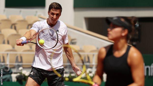 Joe Salisbury and Desirae Krawczyk play at the French Open