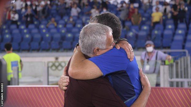 Jose Mourinho and Alessio Dionisi embrace.
