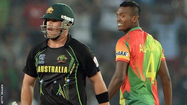 Australia's Aaron Finch and Bangladesh's Al-Amin Hossain