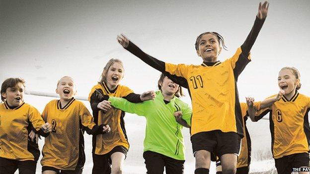 girls football team celebrating