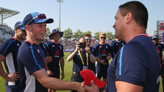 Mason Crane is presented with his first England cap by Adam Hollioake