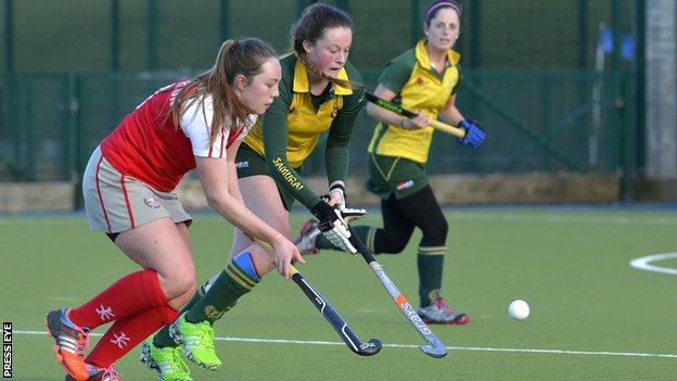 Rosie Henderson of Pegasus and Railway Union's Grace McLoughlin battle for possession in the Belfast clash