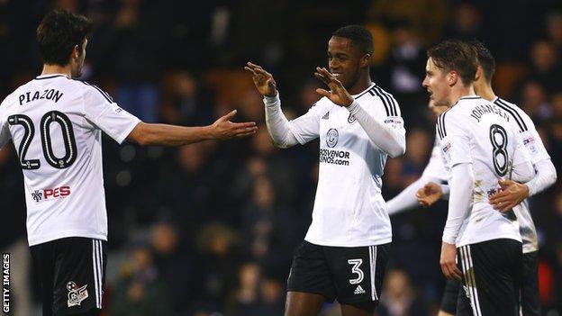 Ryan Sessegnon celebrates a goal with Fulham teammates