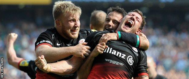 Jackson Wray and Neil de Kock celebrate with Alex Goode after the full-back's late try against Exeter