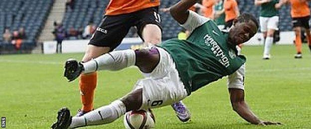 Marvin Bartley goes down under a challenge from Chris Erskine