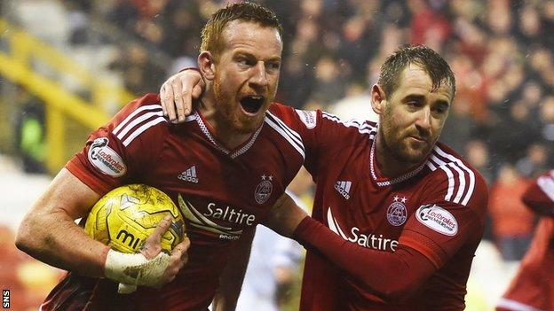 Adam Rooney and Niall McGinn celebrate Aberdeen's late equaliser